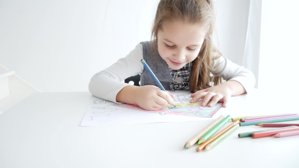 Little Girl Drawing a Picture on White Room 7 Years Old ...